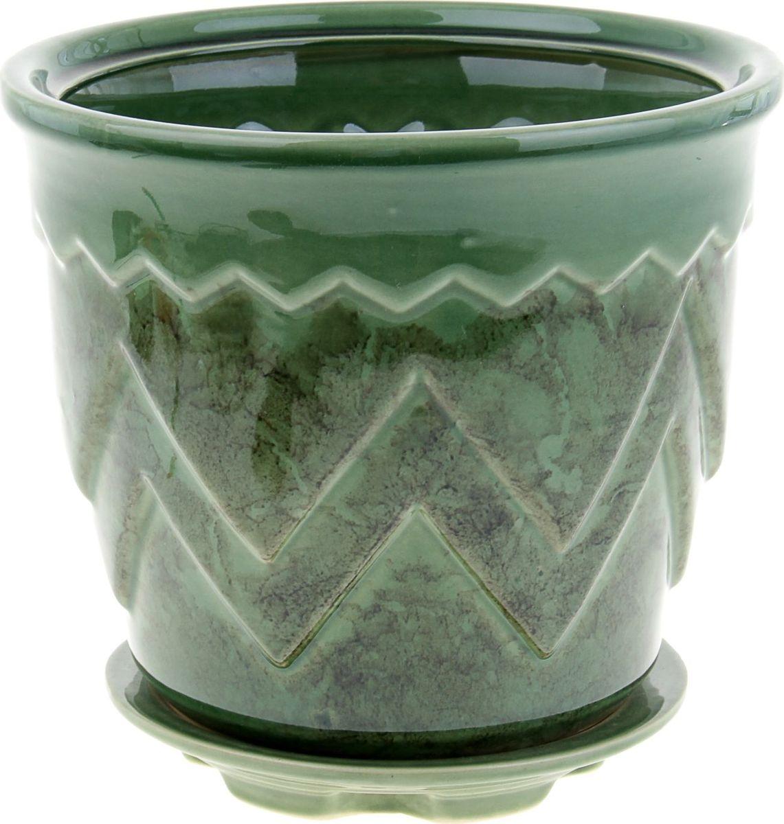 Кашпо Арго, цвет: зеленый, 2,8 л840511Комнатные растения — всеобщие любимцы. Они радуют глаз, насыщают помещение кислородом и украшают пространство. Каждому из них необходим свой удобный и красивый дом. Кашпо из керамики прекрасно подходят для высадки растений: за счёт пластичности глины и разных способов обработки существует великое множество форм и дизайновпористый материал позволяет испаряться лишней влагевоздух, необходимый для дыхания корней, проникает сквозь керамические стенки! #name# позаботится о зелёном питомце, освежит интерьер и подчеркнёт его стиль.