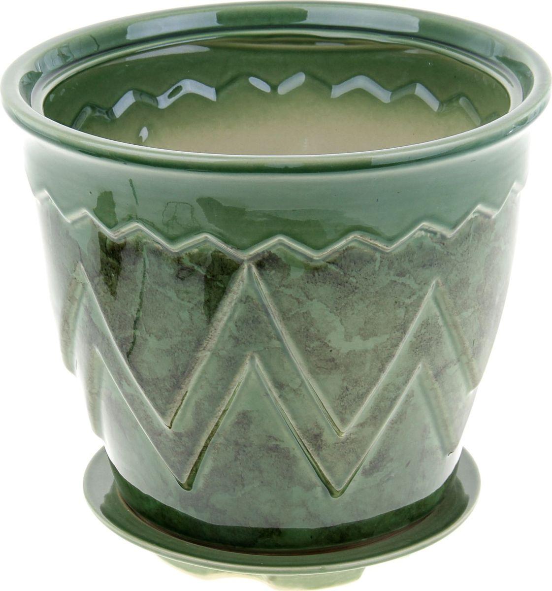Кашпо Арго, цвет: зеленый, 6 л840512Комнатные растения — всеобщие любимцы. Они радуют глаз, насыщают помещение кислородом и украшают пространство. Каждому из них необходим свой удобный и красивый дом. Кашпо из керамики прекрасно подходят для высадки растений: за счёт пластичности глины и разных способов обработки существует великое множество форм и дизайновпористый материал позволяет испаряться лишней влагевоздух, необходимый для дыхания корней, проникает сквозь керамические стенки! #name# позаботится о зелёном питомце, освежит интерьер и подчеркнёт его стиль.