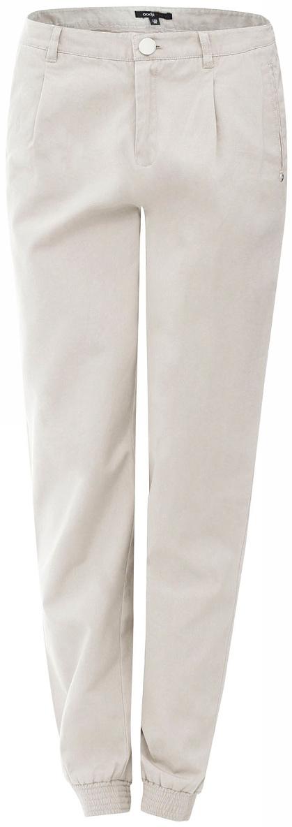 Брюки женские oodji Ultra, цвет: кремовый. 11701026/14119/3000N. Размер 40-170 (46-170)11701026/14119/3000NЖенские брюки от oodji зауженного кроя выполнены из натурального хлопка. Брючины дополнены эластичными манжетами.