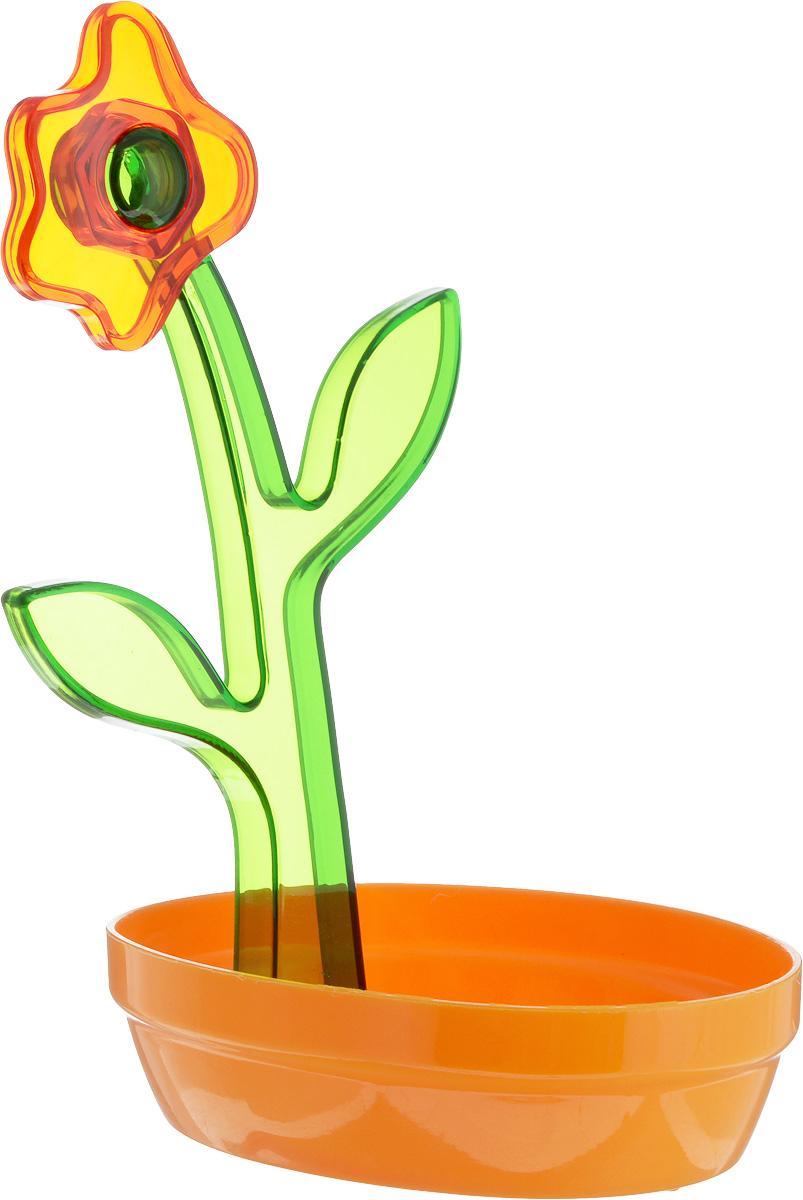 Подставка под ложку Herevin, цвет: оранжевый, зеленый161250-000Подставка под ложку Herevin изготовлена из высококачественного пищевого пластика. Изделие выдерживает высокие температуры, что позволяет использовать его как подставку под кухонные принадлежности, которыми вы готовите, например, половник или лопатку. Подставка защитит поверхность стола от высоких температур и поможет сохранить чистоту на кухне. Декоративный элемент в виде цветка сделает подставку оригинальным украшением кухонного интерьера.