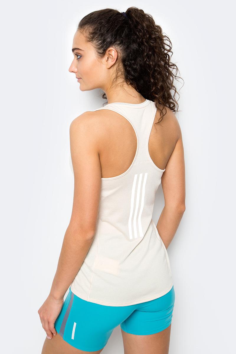 Спортивная женская майка Майка женская Sn Tnk W для энергичных тренировок, где требуется максимальная свобода движений. Модель из ткани с технологией climalite эффективно отводит излишки влаги, сохраняя свежесть. Майка имеет приталенный крой, широкие лямки, глубокий круглый ворот, обрамленный светоотражающими полосами и логотип adidas вверху слева.