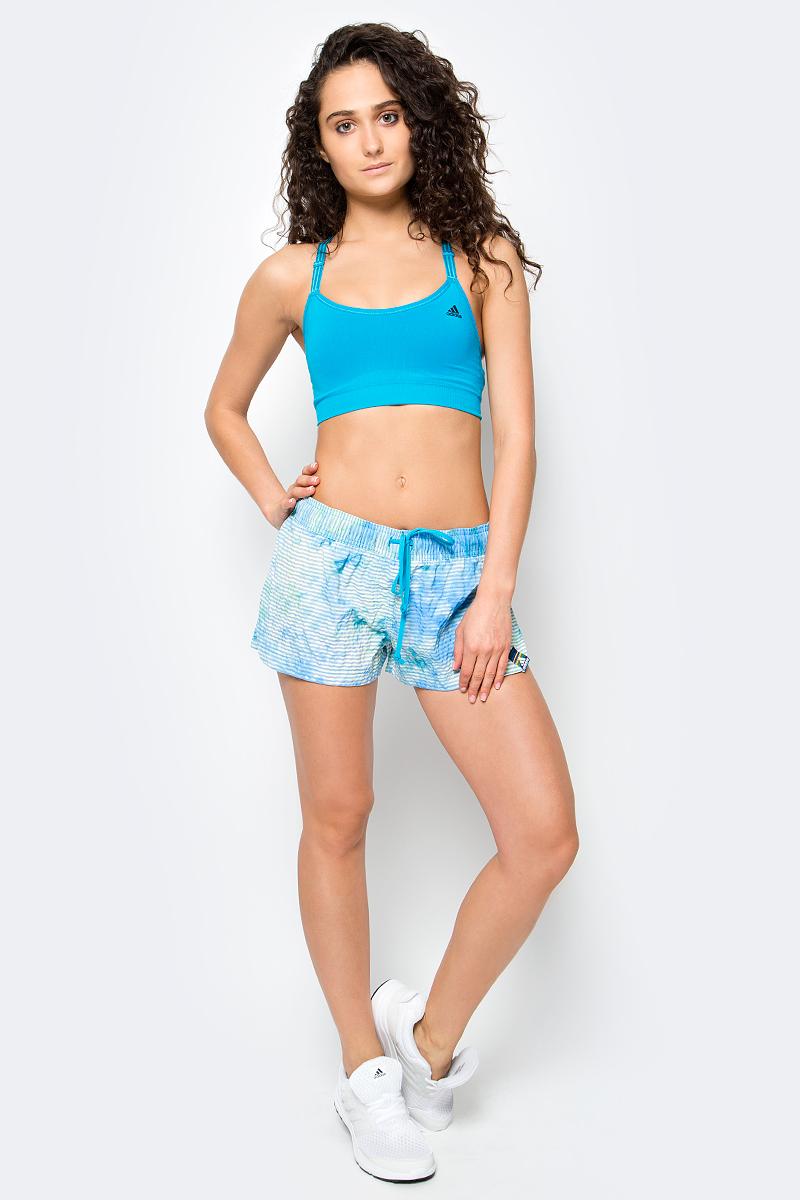Топ-бра для фитнеса женский Adidas Seamless Bra, цвет: бирюзовый. BK2146. Размер L (48/50)BK2146Этот спортивный бюстгальтер обеспечит тебе максимальный уровень комфорта даже во время интенсивных тренировок. Бесшовная модель с низкой степенью поддержки дополнена регулируемыми бретелями для идеальной посадки. Функциональная ткань для отвода излишков влаги.Ткань с технологией climalite быстро и эффективно отводит влагу с поверхности кожи, поддерживая комфортный микроклимат.Округлый ворот.Регулируемые лямки с тремя полосками.Низкая степень поддержки, перфорированные чашечки для дополнительной вентиляции и быстрого высыхания.Эластичная нижняя лента, бесшовная конструкция для комфортной посадки.