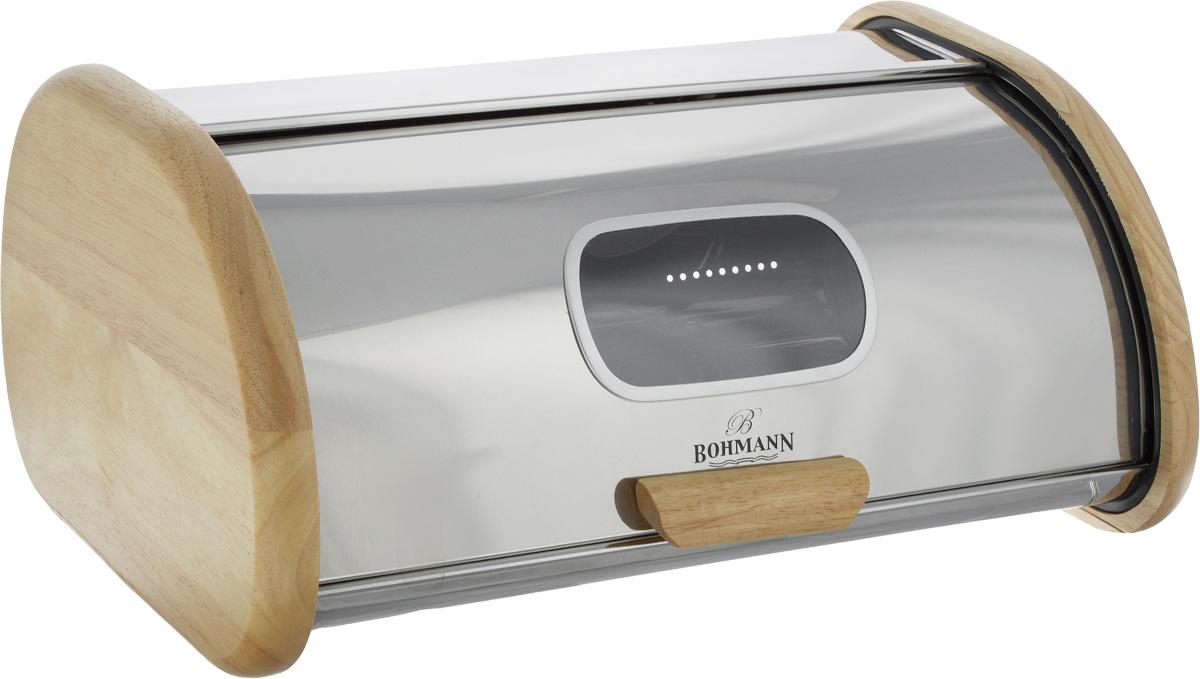 Хлебница Bohmann, 42,5 х 29 х 20 см7245BHХлебница Bohmann изготовлена из высококачественной нержавеющей стали c зеркальной полировкой. Компактная в использовании, хлебница не требует дополнительного места при открывании крышки. Крышка с окошком гладко скользит внутрь корпуса при открытии. Задняя стенка хлебницы оснащена отверстиями для циркуляции воздуха. Боковые стенки и ручка отделаны вставками из натурального дерева. Хлебница Bohmann позволит надолго сохранить свежесть, мягкость, аромат хлеба и других хлебобулочных изделий. Она отличается стильным классическим дизайном и впишется в любой кухонный интерьер.
