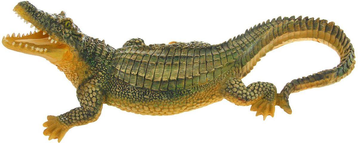 Фигура садовая Крокодил, цвет: желтый, зеленый, 89 х 32 х 37 см1306968Создайте настроение в любимом саду: украсьте его оригинальным декором. Представители фауны разнообразят ландшафт. Гармоничнее всего фигуры будут смотреться в местах природного обитания: например, белочки — вблизи деревьев, а лягушки — у водоёмов.Сделайте свой сад неповторимым. Разрабатывайте собственный дизайн и расставляйте акценты. Хотите привлечь внимание к клумбе? Поставьте садовую фигуру рядом с ней. А расположенная прямо у калитки, она будет приятно удивлять гостей. Такой декор легко замаскирует неприглядные детали на участке.Садовая фигура из полистоуна (искусственного камня) — оптимальное решение для уличных условий. Этот материал не выцветает на солнце, даже если находится под воздействием ультрафиолета круглый год. Искусственный камень имеет низкую пористость, поэтому ему не страшна влага и на нём не появятся трещины. Садовая фигура будет хранить красоту сада долгие годы.