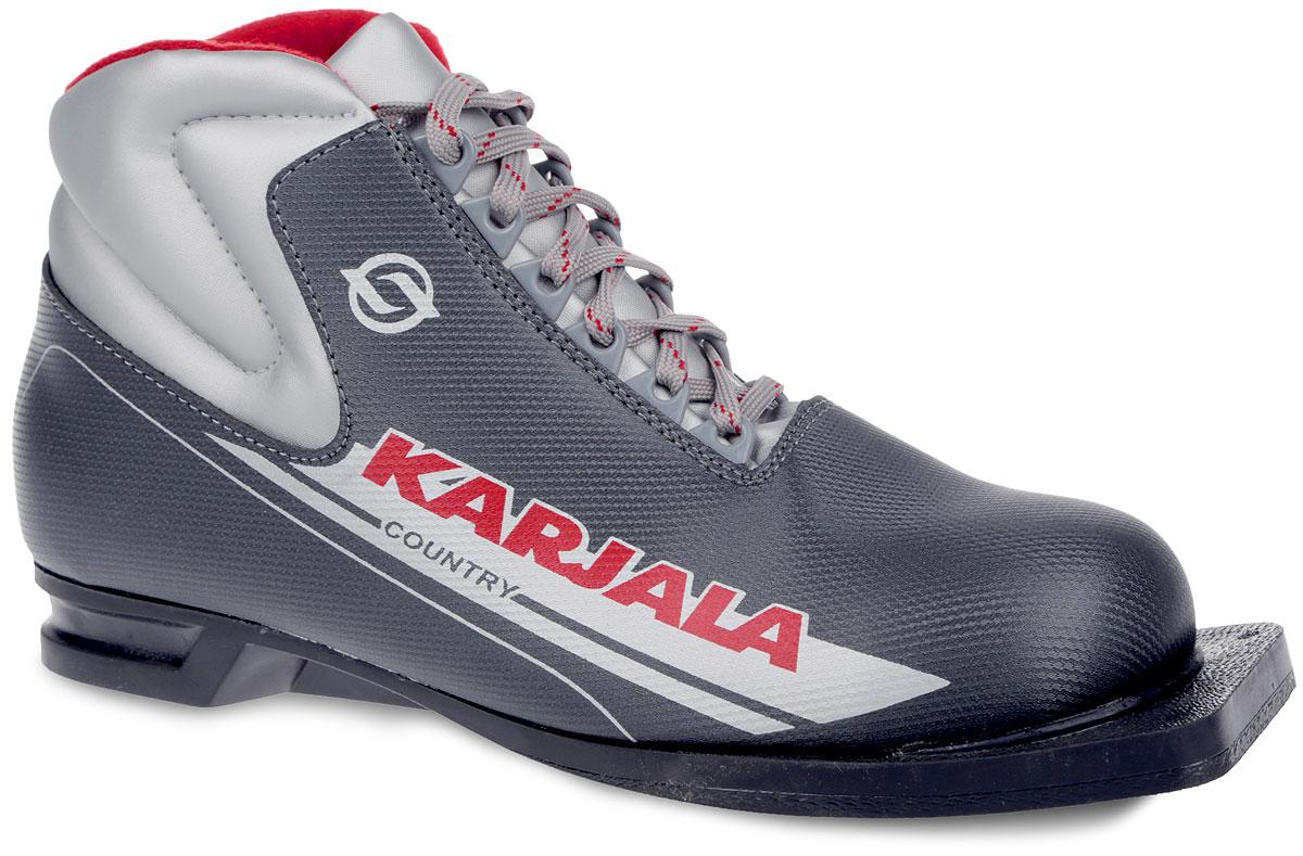 Ботинки лыжные Karjala Country, 75 мм, цвет: серый. Размер 41Country 75Ботинки для беговых лыж Country от Karjala предназначены для классического стиля. Модель изготовлена из морозостойкой искусственной кожи и имеет утеплитель из искусственного меха и капровелюра, благодаря чему ваши ноги всегда будут в тепле. Шерстяная стелька комфортна при беге.Вставки в мысовой и пяточной частях обеспечивают дополнительную жесткость, позволяя дольше сохранять первоначальную форму ботинка и предотвращать натирание cтопы. Ботинки снабжены шнуровкой с пластиковыми петлями и язычком-клапаном, который защищает от попадания снега и влаги.Подошва шириной 75 мм из двухкомпонентной резины является надежной и весьма простой системой крепежа, и позволяет безбоязненно использовать ботинок до -30°С. В таких лыжных ботинках вам будет комфортно и уютно.
