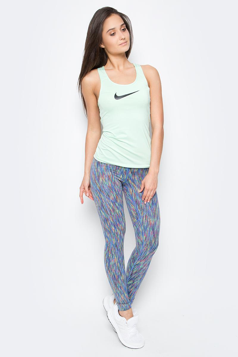 Тайтсы женские Nike Tights Veneer, цвет: синий, мультиколор. 831931-478. Размер L (46/48)831931-478Бесшовная конструкция женских тайтсов от Nike способствует воздухопроницаемости, сохранению тепла и поддержке, позволяя создать женственный стиль. Легкая трикотажная ткань повторяет контуры тела, защищает от холода и позволяет полностью сконцентрироваться на тренировке.Технология Nike Pro HyperWarm отводит влагу и обеспечивает зональную защиту от холода. Боковые швы выгодно подчеркивают фигуру и обеспечивают естественную посадку.Плоский эластичный пояс для облегающей посадки и фиксации.Разноцветные нити насыщенных цветов создают визуальный эффект текстуры.На нижней части левого бедра нанесен принт с логотипом Swoosh.