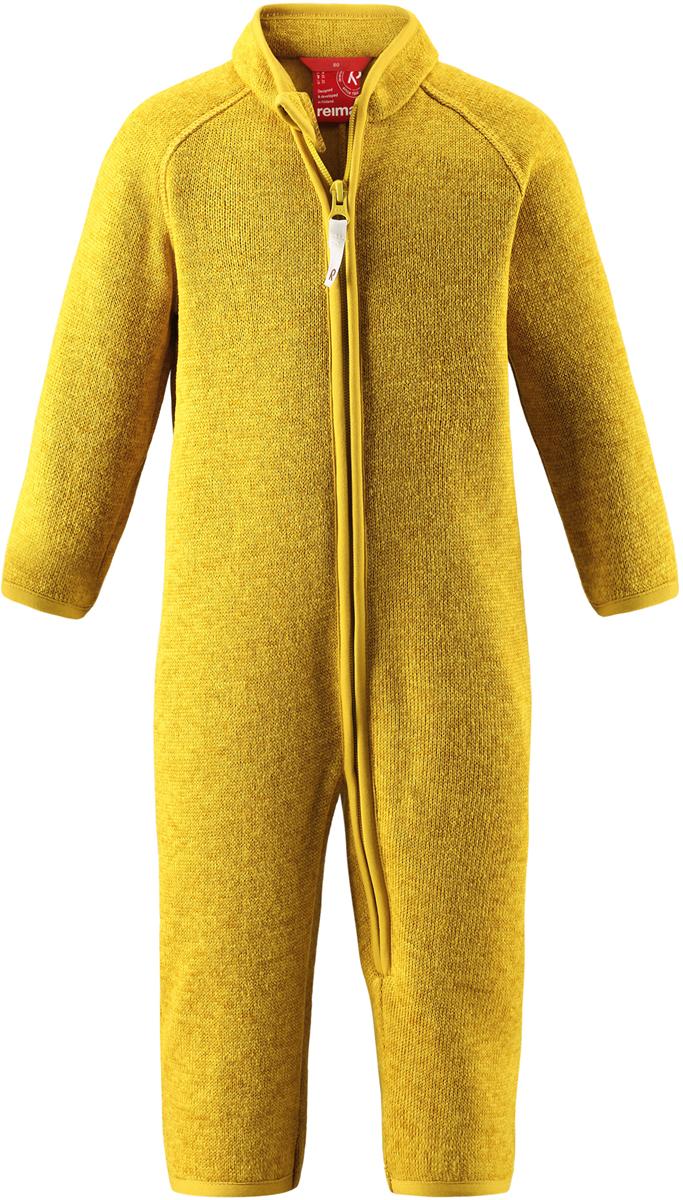 Комбинезон флисовый детский Reima Tahti, цвет: желтый. 5163202390. Размер 925163202390Легкий и мягкий флисовый комбинезон, поддетый под верхнюю одежду, согреет малышей в морозные зимние дни, но при этом его можно носить и в помещении! Этот флисовый комбинезон для малышей снабжен молнией во всю длину, чтобы облегчить процесс надевания, и защитой для подбородка, которая не даст поцарапать шею и подбородок. Он сшит из мягкого и очень популярного меланжевого вязаного флиса, который объединил в себе стильный вязаный дизайн и все преимущества флиса: теплый и приятный на ощупь флис быстро сохнет, выводя влагу в верхние слои одежды – идеальный выбор для активных прогулок и веселых приключений на свежем воздухе!