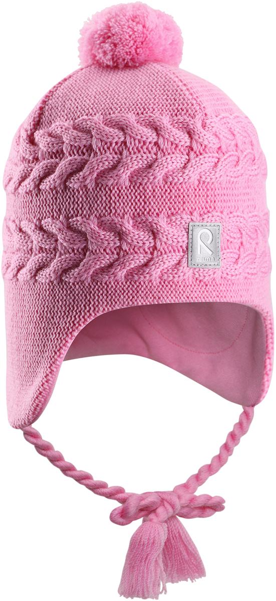 Шапка-бини для девочки Reima Hiutale, цвет: розовый. 5184284190. Размер 525184284190Красивая шерстяная шапка для малышей Reima станет отличным вариантом на зимние холода. Шапка связана из мериносовой шерсти и снабжена уютной и мягкой трикотажной подкладкой. Ветронепроницаемые вставки защищают ушки в ветреную погоду, а завязки-косички, структурная вязка и веселый помпон завершают образ.