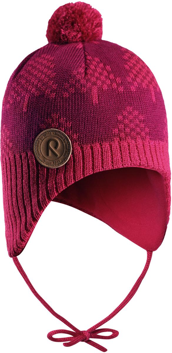 Шапка-бини для девочки Reima Yllas, цвет: розовый. 5184303560. Размер 465184303560Шерстяная шапка для малышей Reima с чудесным рисунком надежно согреет в холодный зимний день. Эта шапка для малышей из мериносовой шерсти подарит уют в морозную погоду: мягкая флисовая подкладка обеспечит ребенку тепло и комфорт. За счет эластичной вязки шапка отлично сидит, а ветронепроницаемые вставки в области ушей защищают ушки от холодного ветра. Благодаря завязкам, эта стильная шапка не съезжает и хорошо защищает голову. Маленький помпон на макушке довершает образ.