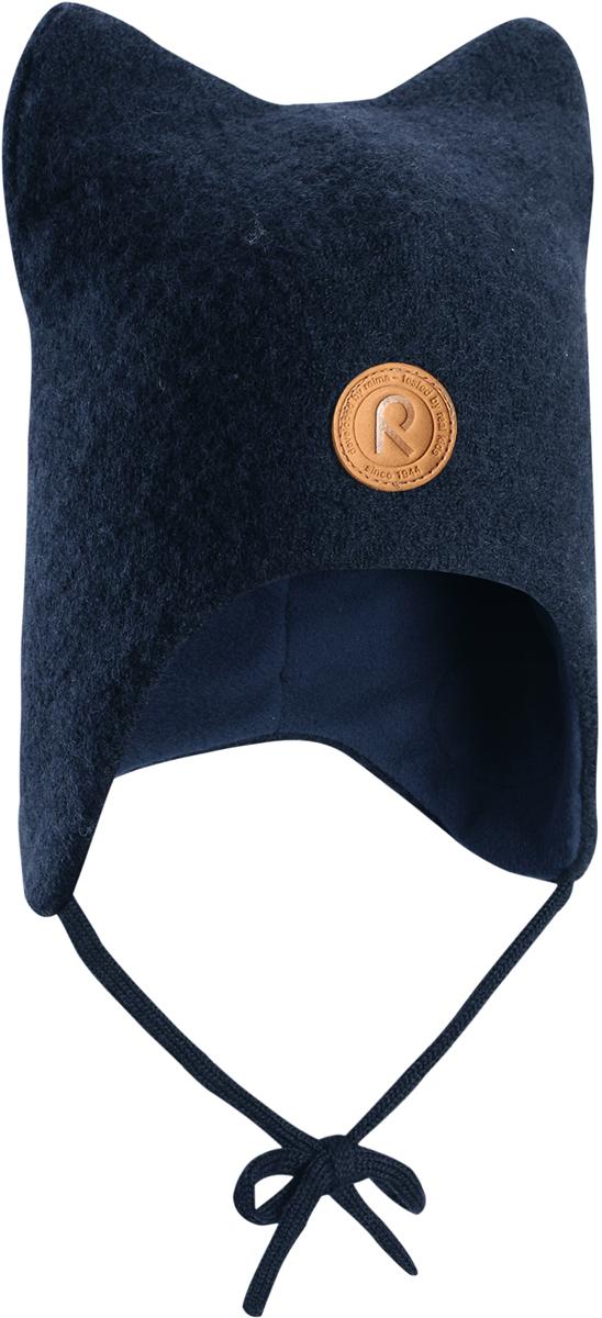 Шапка-бини детская Reima Otus, цвет: синий. 5184356980. Размер 465184356980Детская шерстяная шапка Reima из красивого, бархатного на ощупь материала не боится мороза. Шапка связана из шерсти, которая является идеальным терморегулятором, и подшита приятной на ощупь флисовой подкладкой. Ветронепроницаемые вставки в области ушей и завязки надежно защитят от холодного ветра.