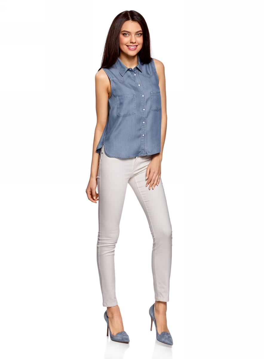 Блузка женская oodji Ultra, цвет: синий джинс. 19009007/42579/7500W. Размер 36-170 (42-170)19009007/42579/7500WЖенская блузка от oodji выполнена из лиоцелла. Модель без рукавов и отложным воротником застегивается на кнопки, на груди дополнена накладными карманами.