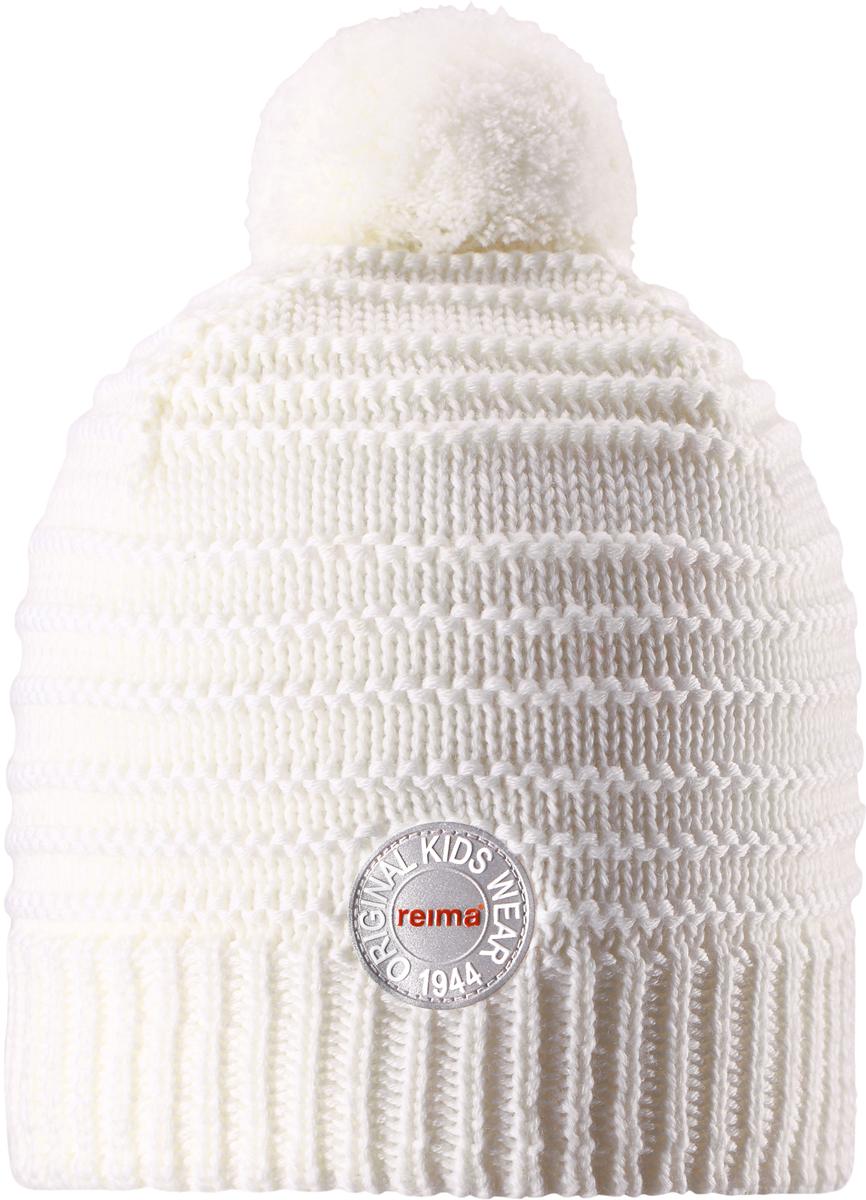 Шапка-бини детская Reima Hurmos, цвет: белый. 5285530100. Размер 565285530100Шапка для малышей и детей постарше Reima изготовлена из дышащей и теплой мериносовой шерсти. Мягкая флисовая подкладка гарантирует тепло, а ветронепроницаемые вставки между верхним слоем и подкладкой защищают уши. Модель выполнена узорной вязкой и дополнена помпоном на макушке.