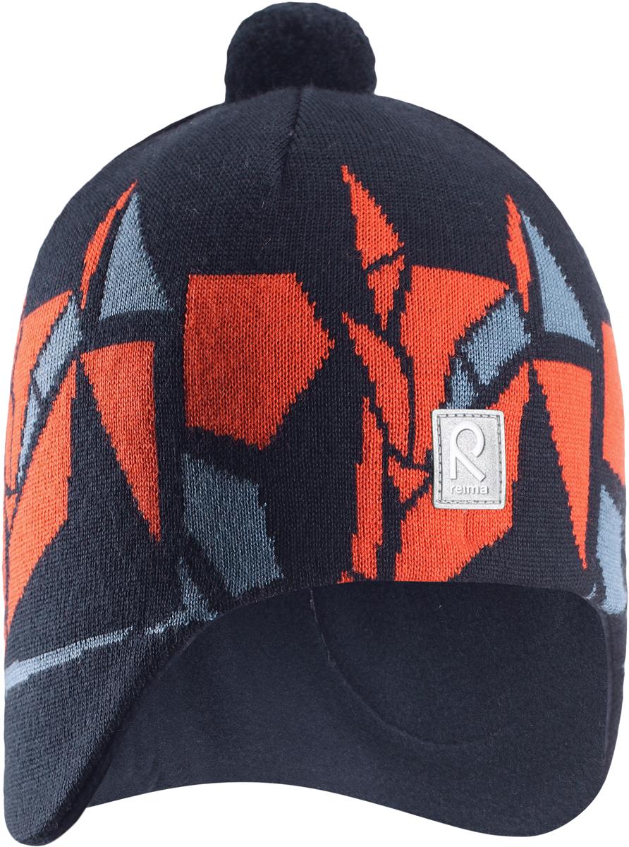 Шапка-бини детская Reima Kaja, цвет: оранжевый, темно-синий. 5285486980. Размер 505285486980Яркая шерстяная шапка для малышей и детей постарше Reima станет отличным вариантом на зимние холода. Шапка выполнена из шерсти и снабжена мягкой трикотажной подкладкой. Ветронепроницаемые вставки защищают ушки в ветреную погоду. Модель украшена цветным геометрическим рисунком и дополнена помпоном на макушке.