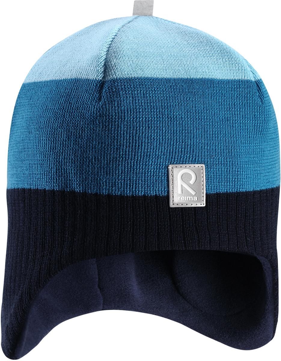 Шапка-бини детская Reima Lumula, цвет: синий. 528546698C. Размер 52528546698CДетская шерстяная шапка Reima закрывает уши ребенка и защищает лоб даже без завязок. Стильная шапка из 100% шерсти подшита удобной теплой флисовой подкладкой из полиэстера. Материал быстро сохнет и обладает влагоотводящими свойствами. Ветронепроницаемые вставки между верхним слоем и подкладкой обеспечивают ушкам дополнительную защиту от ветра.