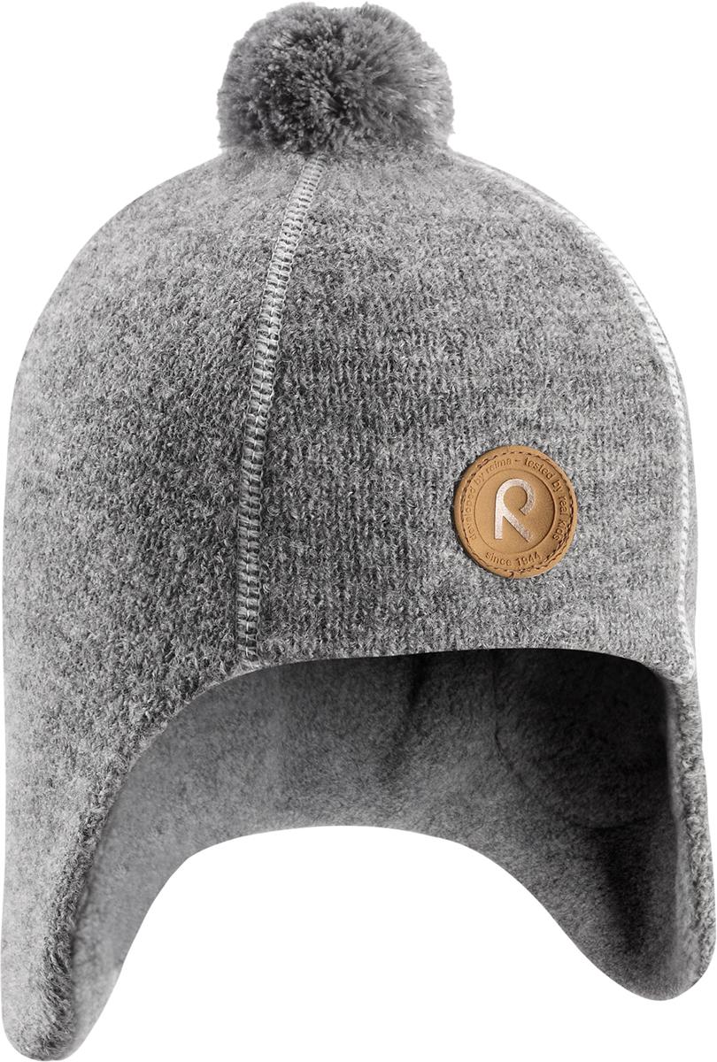 Шапка-бини детская Reima Reipas, цвет: серый. 5285589400. Размер 545285589400Невероятно теплая детская шерстяная шапка Reima отлично согреет на прогулке в морозный зимний день. Шапка, подшитая мягким и теплым флисом из полиэстера, обеспечит ребенку тепло и сухость во время активных игр на свежем воздухе, а интересная фетровая структура и веселый помпон на макушке придают этой забавной модели завершающий штрих. Эта модель хорошо закрывает и защищает лоб и ушки, а ветронепроницаемые вставки в области ушей обеспечивают дополнительную защиту от пронизывающего ветра.