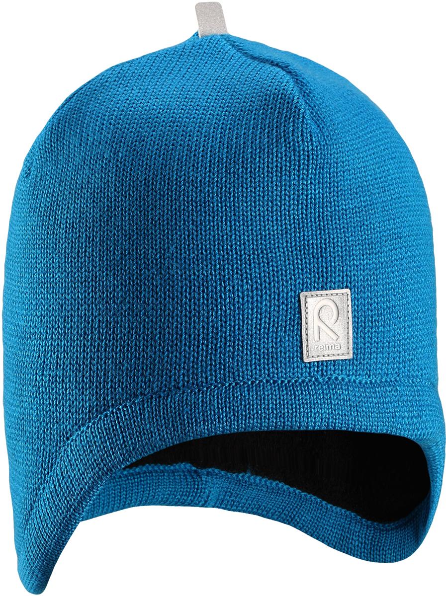 Шапка-бини детская Reima Viita, цвет: синий. 5285606490. Размер 505285606490Шапка для малышей и детей постарше из теплого шерстяного трикотажа. Материал превосходно регулирует температуру и хорошо согревает голову. Практичный фасон обеспечивает надежную защиту ушек: шапка снабжена ветронепроницаемые вставками и подкладкой из мягкого флиса.