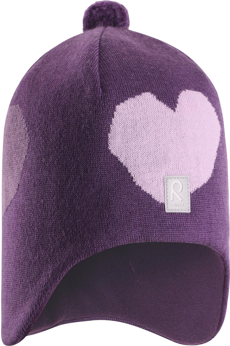 Шапка-бини для девочки Reima Vadelma, цвет: лиловый. 5285475930. Размер 525285475930Мягкая и удобная шапка Reima для малышей отлично подойдет для теплых солнечных деньков. Она сделана из мягкой мериносовой шерсти, которая превосходно регулирует температуру. Снабжена полной подкладкой из удобного джерси из смеси хлопка и эластана и ветронепроницаемыми вставками в области ушей. Сплошная жаккардовая узорная вязка и помпон на макушке завершают образ.