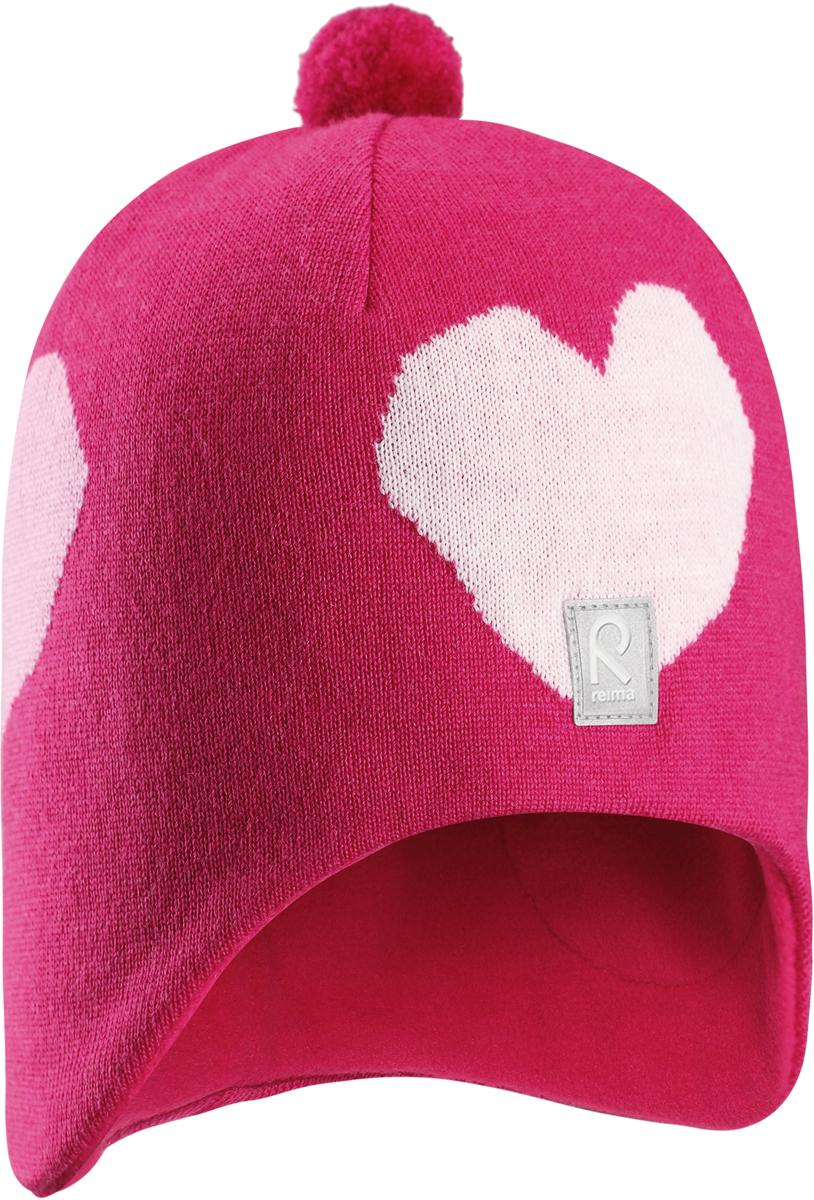 Шапка-бини для девочки Reima Vadelma, цвет: розовый. 5285473560. Размер 525285473560Мягкая и удобная шапка Reima для малышей отлично подойдет для теплых солнечных деньков. Она сделана из мягкой мериносовой шерсти, которая превосходно регулирует температуру. Снабжена полной подкладкой из удобного джерси из смеси хлопка и эластана и ветронепроницаемыми вставками в области ушей. Сплошная жаккардовая узорная вязка и помпон на макушке завершают образ.