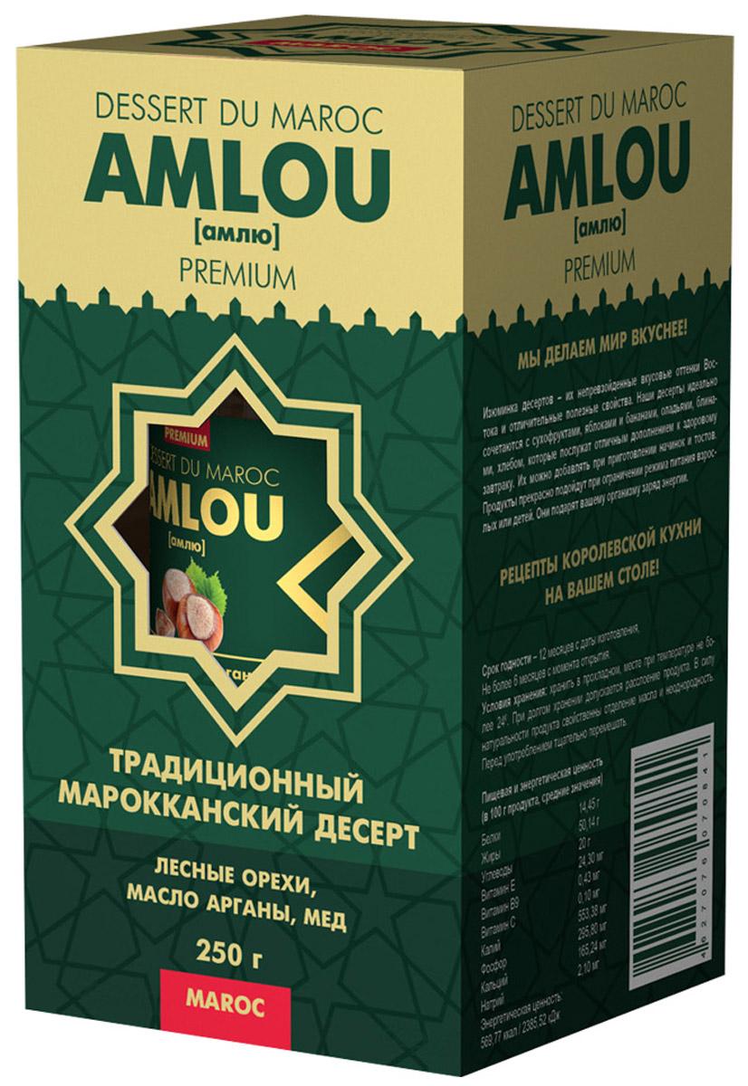Dessert du Maroc Amlou Марокканская ореховая паста с фундуком и маслом арганы, 250 г10021Традиционный марокканский десерт из масла арганы, орехов и цветочного меда. Предназначен для здорового, сбалансированного и полноценного питания. Кардинальное отличие амлю от других десертов в том, что этот продукт содержит ценное масло арганы, являющегося источником витамина Е и полиненасыщенных жирных кислот Омега-6, Омега-9. Оно полностью усваивается организмом человека и способствует замедлению процесса старения клеток.МАСЛО АРГАНЫМасло арганы широко известно в мире, и его полезные свойства успешно применяют в медицине, кулинарии. Пищевое масло арганы получают прессованием семян арганового дерева. При регулярном употреблении в пищу аргановое масло нормализует показатели артериального давления и сердцебиения. Всего пара столовых ложек в течение дня препятствует развитию инфекций бактериальной и грибковой природы. Следует также отметить, что масло арганы при регулярном употреблении в несколько раз снижает вероятность возникновения и развития злокачественных опухолей, повышает защитные силы организма, а также стимулирует выведение из организма накопившихся в нем вредных веществ, используется в качестве продукта для заправки салатов и дополнительного ингредиента в приготовлении вкусных и питательных завтраков.ОРЕХИФундук обладает ценным сбалансированным составом биологически активных веществ, благотворно воздействующих на весь организм человека, укрепляет, оздоравливает, восполняет запасы нужных веществ, улучшает работу головного мозга.МЕД ЦВЕТОЧНЫЙ100% натуральный из цветков апельсинового дерева. Регулярное употребление меда в пищу повышает иммунитет, делая организм более устойчивым к инфекциям.Десерты АМЛЮ очень питательны и могут использоваться как дополнение к ежедневному рациону, дающее организму энергию и даже свободно заменяющее полноценные завтрак, обед и ужин. Десерты прекрасно зарекомендовали себя при соблюдении диет, постов и после операционных вмешательств. Десерты г