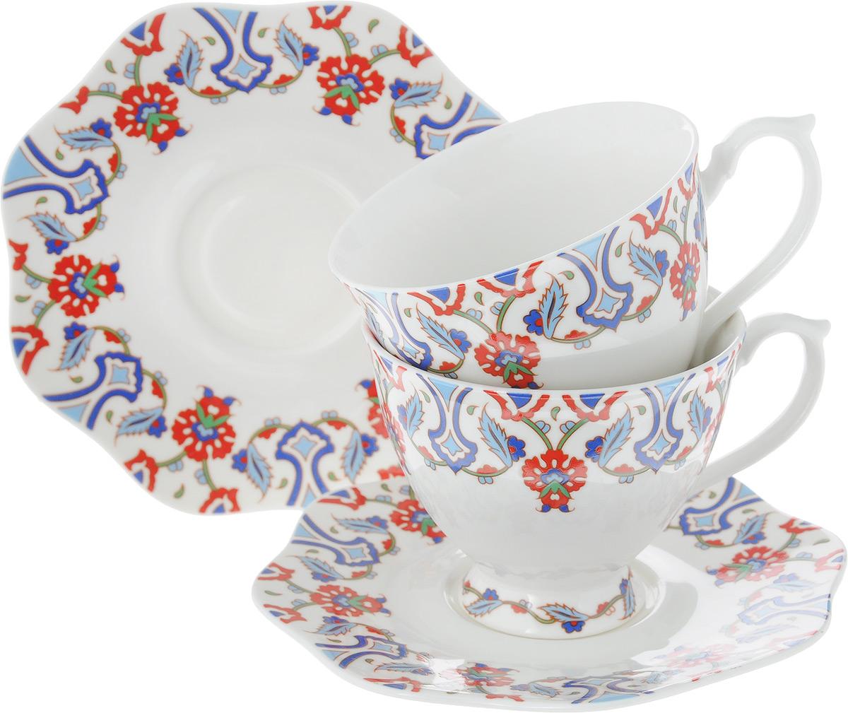 """Чайный набор """"Loraine"""" на 2 персоны выполнен из высококачественного костяного фарфора - материала, безопасного для здоровья и надолго сохраняющего тепло напитка. В наборе 2 чашки и 2 блюдца. Несмотря на свою внешнюю хрупкость, каждый из предметов набора обладает высокой прочностью и надежностью.    Изделия дополнены ярким красивым узором. Оригинальный дизайн сделает этот набор изысканным украшением любого стола.    Набор упакован в подарочную коробку в форме сердца, поэтому его можно преподнести в качестве оригинального и практичного подарка для родных и близких.  Объем чашки: 180 мл.    Диаметр чашки (по верхнему краю): 8 см.    Высота чашки: 7 см.    Диаметр блюдца: 14 см."""