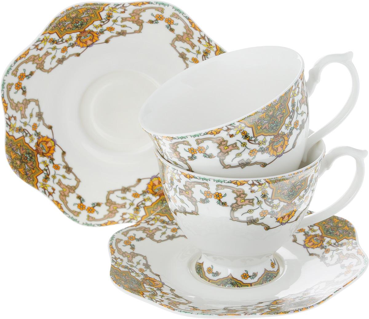 Набор чайный Loraine, 4 предмета. 2661726617Чайный набор Loraine на 2 персоны выполнен из высококачественного костяного фарфора - материала, безопасного для здоровья и надолго сохраняющего тепло напитка. В наборе 2 чашки и 2 блюдца. Несмотря на свою внешнюю хрупкость, каждый из предметов набора обладает высокой прочностью и надежностью.Изделия дополнены ярким красивым узором. Оригинальный дизайн сделает этот набор изысканным украшением любого стола.Набор упакован в подарочную коробку в форме сердца, поэтому его можно преподнести в качестве оригинального и практичного подарка для родных и близких.Объем чашки: 180 мл.Диаметр чашки (по верхнему краю): 8,5 см.Высота чашки: 7 см.Диаметр блюдца: 14 см.