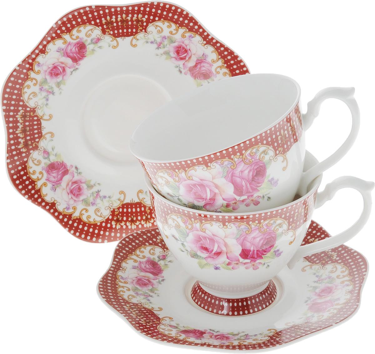 Набор чайный Loraine, 4 предмета. 2662226622Чайный набор Loraine на 2 персоны выполнен из высококачественного костяного фарфора - материала, безопасного для здоровья и надолго сохраняющего тепло напитка. В наборе 2 чашки и 2 блюдца. Несмотря на свою внешнюю хрупкость, каждый из предметов набора обладает высокой прочностью и надежностью. Изделия дополнены ярким красивым узором. Оригинальный дизайн сделает этот набор изысканным украшением любого стола. Набор упакован в подарочную коробку в форме сердца, поэтому его можно преподнести в качестве оригинального и практичного подарка для родных и близких. Объем чашки: 180 мл. Диаметр чашки (по верхнему краю): 8,5 см. Высота чашки: 7 см. Диаметр блюдца: 13,5 см.