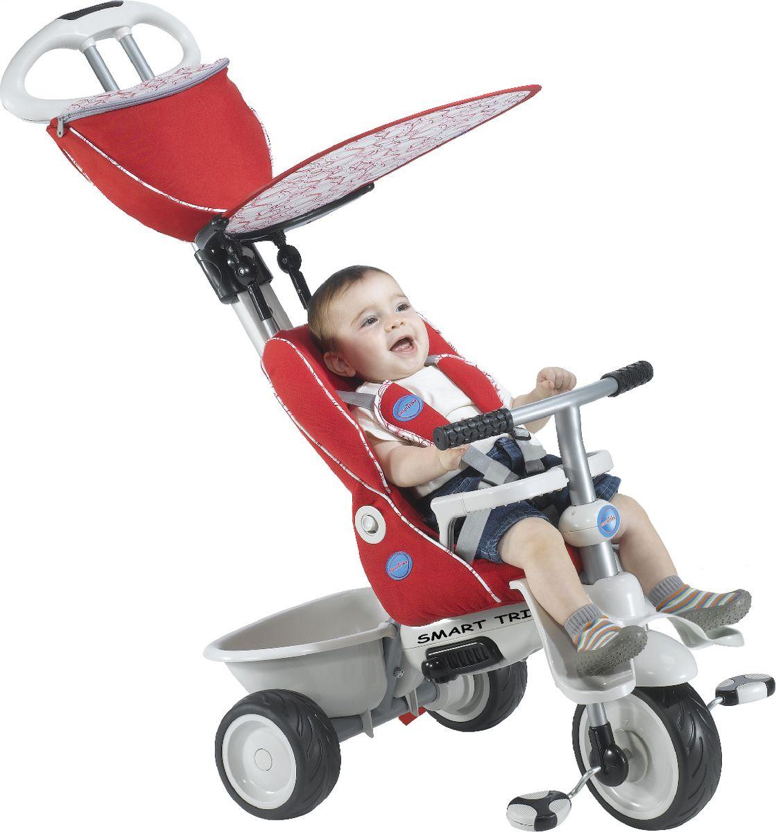 Smart Trike Велосипед трехколесный Recliner цвет красный1911900Трехколесный велосипед Smart Trike Recliner выполнен из прочного пластика и металла. Сиденье велосипеда оборудовано ремнем безопасности, также велосипед имеет небольшой багажник для игрушек. Это единственный на сегодняшний день велосипед, рассчитанный на самых маленьких детей в возрасте от шести месяцев. Учитывая физические особенности малыша, у велосипеда есть дополнительная подставка для ножек шестимесячных детей. Мягкое удобное сиденье, оборудованное 3-точечными ремнями безопасности и защитным поручнем, сделает прогулку не только комфортной, но и максимально безопасной. Сиденье имеет возможность регулировки удаленности от руля в двух положениях, а благодаря высокой спинке, которую можно опускать при нажатии на кнопку, и дополнительной боковой поддержке для головы, малыш сможет ехать полулежа и даже вздремнуть во время прогулки. Основные характеристики: резиновые колеса 8,4 / 6,4; управляющая ручка с внутренней тягой; 2 подножки; мягкая накидка на сиденье; 3-точечный ремень безопасности; страховочный обод; корзина; съемный солнцезащитный тент с возможностью регулировки обеспечивает ребенку защиту от ультрафиолетового излучения солнца на 30%; ножная тормозная система; свободный ход педалей; регулировка наклона спинки; регулировка сиденья в 2-х положениях; сумка; держатель для бутылки.