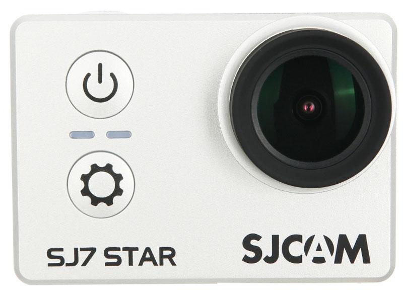 SJCAM SJ7 Star, Silver экшн-камераSJ7STAR_silverSJCAM SJ7 Star - флагман SJCAM, вобравший в себя всё лучшее, что может предложить производитель на данный момент. Это камера с мощной начинкой, впечатляющими характеристиками, 2-дюймовым сенсорным экраном и новым усиленным корпусом.4К-разрешение уже не является экзотикой в том числе и в экшн-камерах, однако далеко не каждая из них снимает видео в данном формате без интерполяции. Между тем новинка записывает видео в реальном и полноценном 4К с частотой 30 кадров в секунду. Помимо этого, экшн-камера SJCAM SJ7 Star порадует своих владельцев множеством других преимуществ.Прочность модели усилена за счет алюминиевой рамки, причем металл использован не только в качестве заявки на премиальность используемых материалов, но и для отвода тепла во время работы гаджета.SJCAM SJ7 Star построена на платформе Ambarella A12S75 — многообещающей новинке одного из двух лидирующих производителей процессоров для экшн-камер. В паре к ней прилагается матрица Sony IMX117, уже хорошо себя зарекомендовавшая. Всё это дает видеокамере преимущества в записи множества форматов, в том числе таких как 1080p (60 кадров/сек.), 4К (30 кадров/сек.) и 1080p (120 кадров/сек.). Как выбрать экшн-камеру. Статья OZON Гид