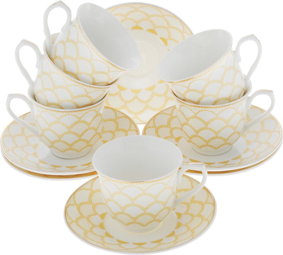 Сервиз кофейный Loraine, 12 предметов. 26436-126436-1Кофейный сервиз Loraine на 6 персон выполнен из высококачественного костяного фарфора - материала, безопасного для здоровья и надолго сохраняющего тепло напитка. В наборе 6 чашек и 6 блюдец. Несмотря на свою внешнюю хрупкость, каждый из предметов набора обладает высокой прочностью и надежностью. Изделия украшены тонкой золотой каймой, внешние стенки дополнены красивым рельефным рисунком. Элегантный классический дизайн сделает этот набор изысканным украшением любого стола. Набор упакован в подарочную коробку, поэтому его можно преподнести в качестве оригинального и практичного подарка для родных и близких. Объем чашки: 80 мл. Диаметр чашки (по верхнему краю): 6 см. Высота чашки: 5,5 см. Диаметр блюдца: 11 см.