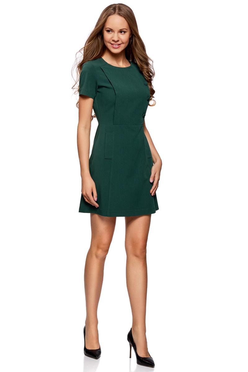 Платье oodji Ultra, цвет: темно-изумрудный. 11902152/38253/6E00N. Размер 36-170 (42-170)11902152/38253/6E00NСтильное платье oodji изготовлено из качественного плотного материала. Модель с короткими рукавами и круглым вырезом застегивается сзади на молнию. Платье оформлено декоративными пуговицами.