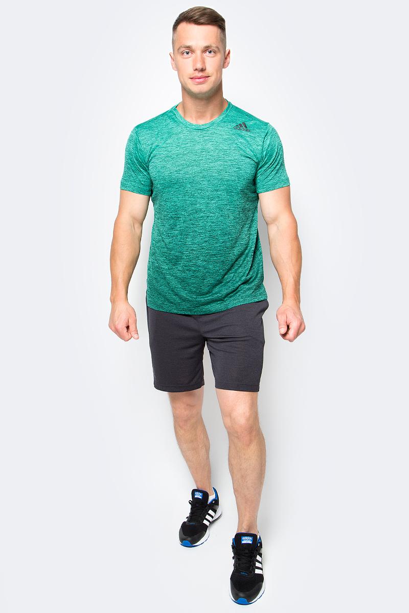 Футболка мужская adidas Freelift Grad, цвет: зеленый. BK6141. Размер M (48/50)BK6141Мужская футболка adidas Freelift Grad выполнена из 100% полиэстера. Ткань с технологией climalite быстро и эффективно отводит влагу с поверхности кожи, поддерживая комфортный микроклимат. Особый крой и строение швов FreeLift обеспечивают поддерживающую посадку для полной свободы движений и не дают модели задираться.