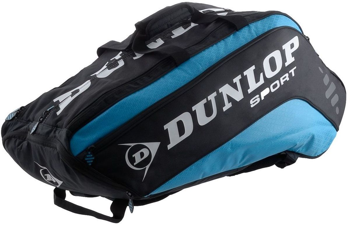 Сумка Dunlop D Tac Bio Pro 10r Therm, на 10 ракеток для тенниса, цвет: голубой, черный817171Сумка Dunlop D Tac Bio Pro 10r Therm предназначена для переноски и хранения ракеток для тенниса. Конструкция выполнена из прочного 1680 и 420D полиэстера. Сумка имеет 3 отделения, вмещающие до 10 ракеток, а также изолированное термо отделение и встроенный карман для обуви или мокрых вещей, боковой карман с внутренними отделениями для телефона/плеера, клипсой для ключей и кармашек для ценных вещей. Сумка имеет эргономичные плечевые лямки для удобства переноски.