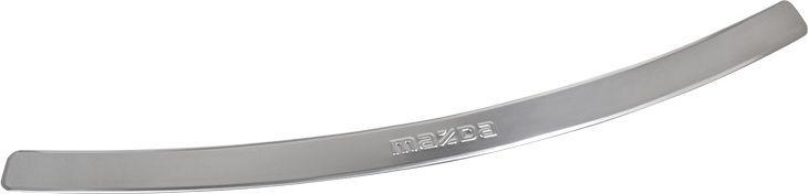 Накладка бампера декоративная DolleX, для Mazda CX-5NBI-005Накладка бампера декоративная DolleX придает автомобилю стильный и неповторимый вид, эффективно защищает бампер от повреждения лакокрасочного покрытия. Подходит для автомобилей Mazda CX-5. На накладке присутствует штамп Mazda.Отличительные особенности:- полированная нержавеющая сталь;- толщина стали 0,5 мм;- стильный внешний вид;- легкая и быстрая установка;- крепление - лента липкая двухсторонняя.