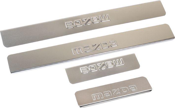 Накладки для порогов DolleX, для Mazda 3 (<-2013), 6 (<-2013), 4 штNPS-027Накладки для порогов DolleX придают автомобилю стильный и неповторимый вид, эффективно защищают пороги от повреждения лакокрасочного покрытия.Отличительные особенности:- Изготовлены из полированной нержавеющей стали,- Толщина стали 0,5 мм,- Стильный внешний вид,- Легкая и быстрая установка,- Крепление - лента липкая двухсторонняя.В комплекте 4 накладки (2 передние, 2 задние).Предназначены специально для Mazda 3 и Mazda 6 до 2013 года выпуска.Размеры: 45 х 5,5 см - 2 шт, 20 х 5,5 см - 2 шт.