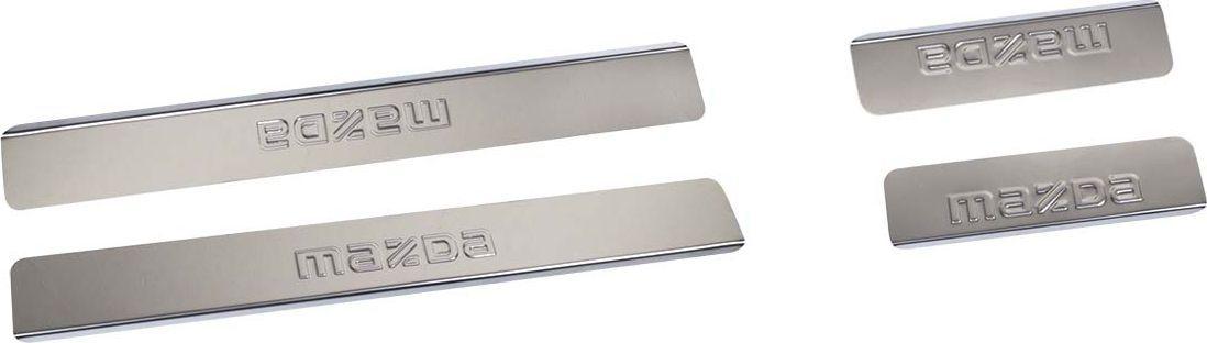 Накладки внутренних порогов DolleX, для MAZDA CX-7, 4 штNPS-030Накладки внутренних порогов DolleX придают автомобилю стильный и неповторимый вид, эффективно защищают пороги от повреждения лакокрасочного покрытия.Отличительные особенности:- Полированная нержавеющая сталь;- Толщина стали 0,5 мм;- Стильный внешний вид;- Легкая и быстрая установка;- Крепление лента липкая двухсторонняя.Комплект:размер 450 х 55мм - 2шт;размер 200 х 55мм - 2шт.