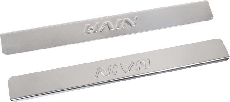 Накладки внутренних порогов DolleX, для ВАЗ-2121, 2 штNPS-204Придают автомобилю стильный и неповторимый вид, эффективно защищают пороги от повреждения лакокрасочного покрытия.Отличительные особенности:- Полированная нержавеющая сталь- Толщина стали 0,5 мм.- Стильный внешний вид- Легкая и быстрая установка- Крепление лента липкая двухсторонняяКомплект:размер 450х55мм - 2шт