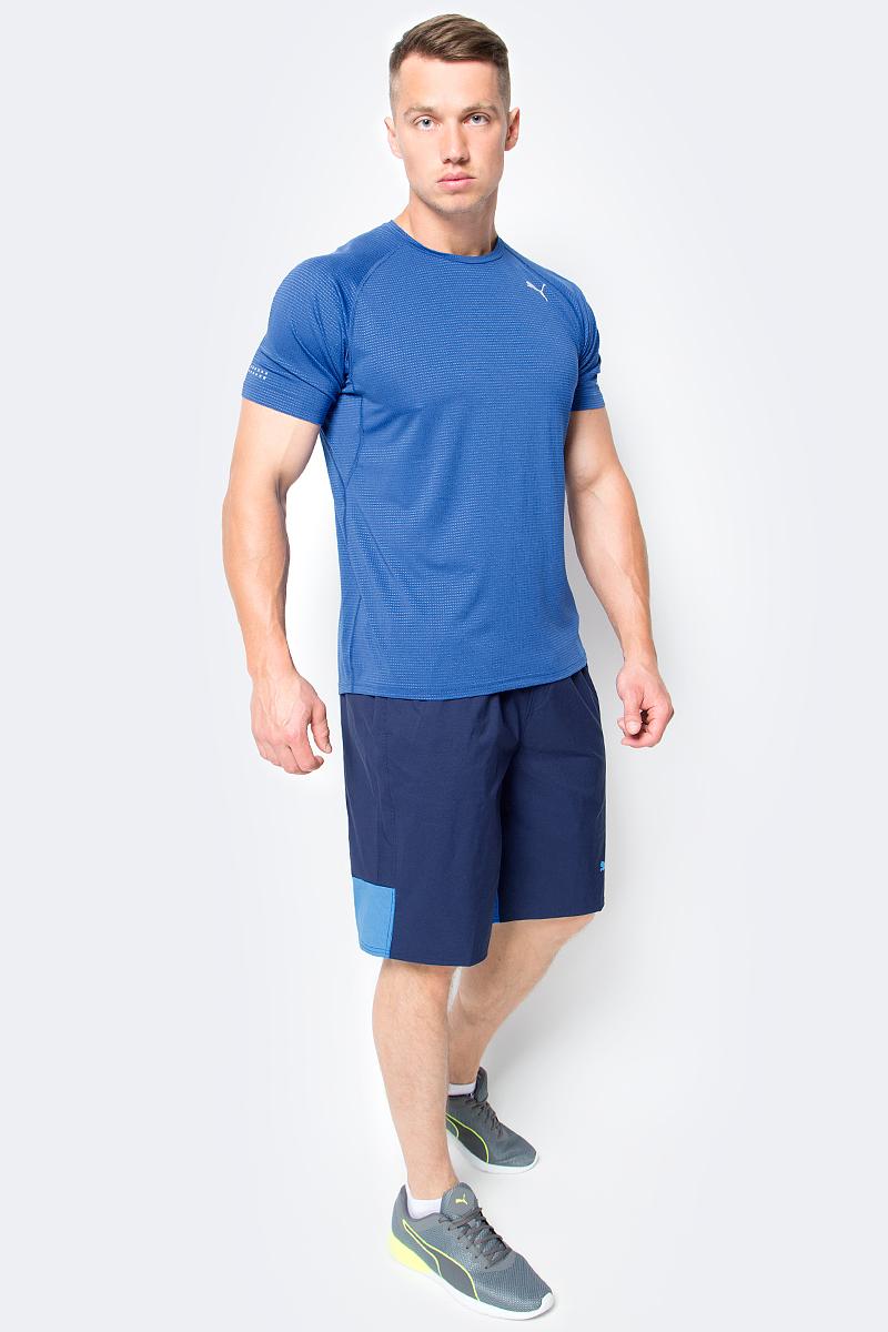 Футболка для бега мужская Puma Speed S/S Tee, цвет: синий. 51499503. Размер M (46/48)51499503Футболка Speed S/S Tee изготовлена с использованием высокофункциональной технологии dryCELL, которая отводит влагу, поддерживает тело сухим и гарантирует комфорт во время активных тренировок и занятий спортом. Она скроена таким образом, чтобы в местах наибольшего натяжения во время бега или активных движений появлялись прорези для улучшения вентиляции, отводящие от тела излишнее тепло. В то же время благодаря передовой технологии Thermo-R при переходе на шаг или остановке эти прорези закрываются, и вы не переохлаждаетесь. Плоские швы не натирают кожу и обеспечивают непревзойденный комфорт. Рукава-реглан обеспечивают полную свободу движений. Удлиненный задний подол не задирается и закрывает поясницу. Футболка декорирована спереди и сзади логотипом и другими элементами из переливающегося светоотражающего материала, благодаря чему вас хорошо видно с любого ракурса в темное время суток.