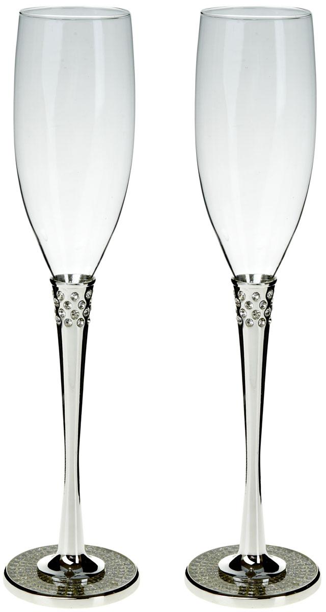 Набор бокалов для шампанского ENS Group Wedding, 200 мл, 2 шт. 52900085290008Набор ENS Group Wedding состоит из двух бокалов для шампанского, выполненных из высококачественного стекла. Изделия обладают кристальной прозрачностью, отличаются долговечностью и прочностью.Бокалы имеют специальную форму чаши, благодаря которой пузырьки не улетучиваются, а значит можно долго наслаждаться напитком. Налитое в такой бокал шампанское полностью раскрывает свой изысканный вкус и неповторимый аромат. Диаметр: 5 см.Высота: 28 см. Объем: 200 мл.