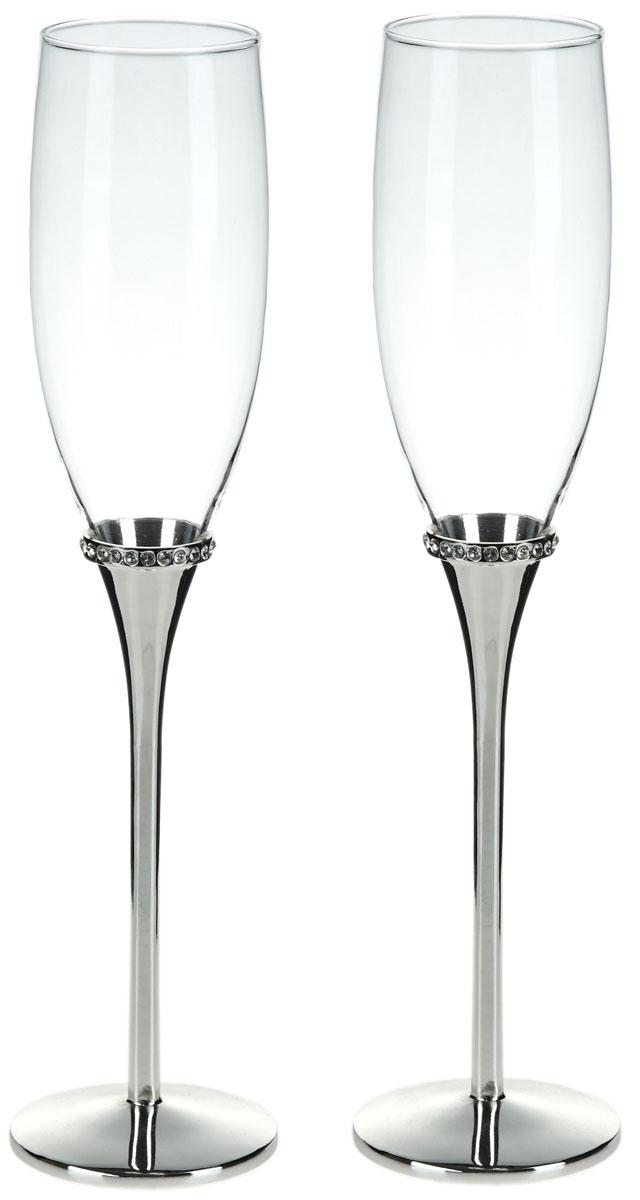 Набор бокалов для шампанского ENS Group Wedding, 200 мл, 2 шт. 52900145290014Набор ENS Group Weddingсостоит из двух бокалов для шампанского, выполненных из высококачественного стекла. Изделия обладают кристальной прозрачностью, отличаются долговечностью и прочностью.Бокалы имеют специальную форму чаши, благодаря которой пузырьки не улетучиваются, а значит можно долго наслаждаться напитком. Налитое в такой бокал шампанское полностью раскрывает свой изысканный вкус и неповторимый аромат. Диаметр: 5 см.Высота: 27 см.Объем: 200 мл.