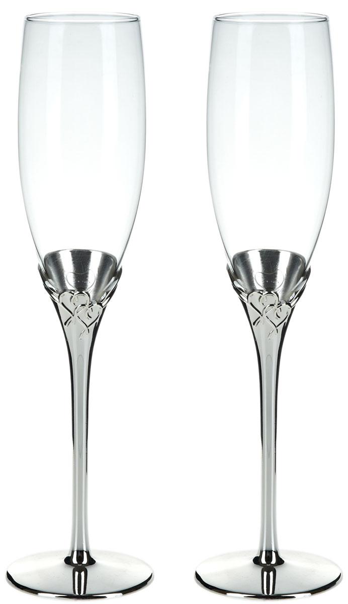 Набор бокалов для шампанского ENS Group Wedding, 200 мл, 2 шт. 52900175290017Набор ENS Group Wedding состоит из двух бокалов для шампанского, выполненных из высококачественного стекла. Изделия обладают кристальной прозрачностью, отличаются долговечностью и прочностью.Бокалы имеют специальную форму чаши, благодаря которой пузырьки не улетучиваются, а значит можно долго наслаждаться напитком. Налитое в такой бокал шампанское полностью раскрывает свой изысканный вкус и неповторимый аромат. Диаметр: 5 см. Высота: 25,5 см. Объем: 200 мл.