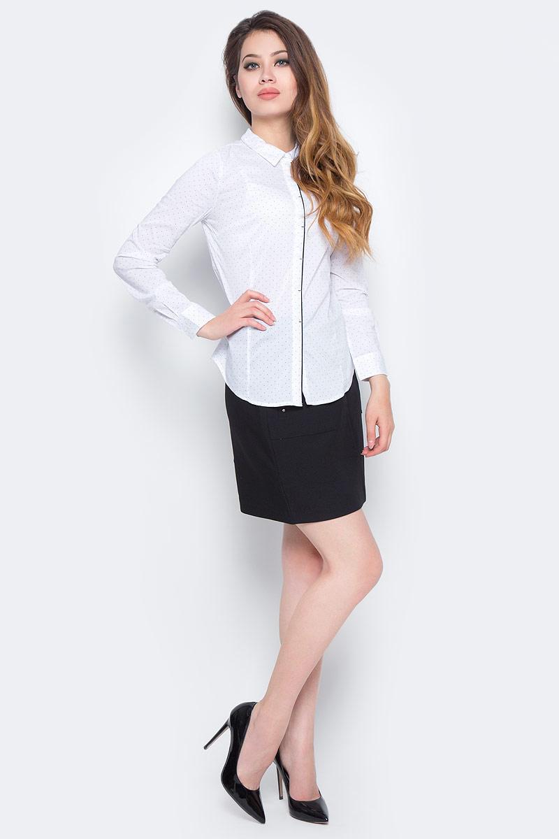 Рубашка женская Sela, цвет: белый. B-112/1300-7350. Размер 46B-112/1300-7350Стильная женская рубашка Sela, изготовленная из качественного материала в мелкий горошек, поможет создать модный образ и станет отличным дополнением к повседневному гардеробу. Модель приталенного кроя с отложным воротничком застегивается спереди на пуговицы, скрытые планкой. Манжеты длинных рукавов также дополнены пуговицей. Модель подойдет для офиса, прогулок или дружеских встреч и будет отлично сочетаться с юбками, а также гармонично смотреться с джинсами и брюками. Мягкая ткань на основе хлопка, нейлона и эластана приятна на ощупь и комфортна в носке.