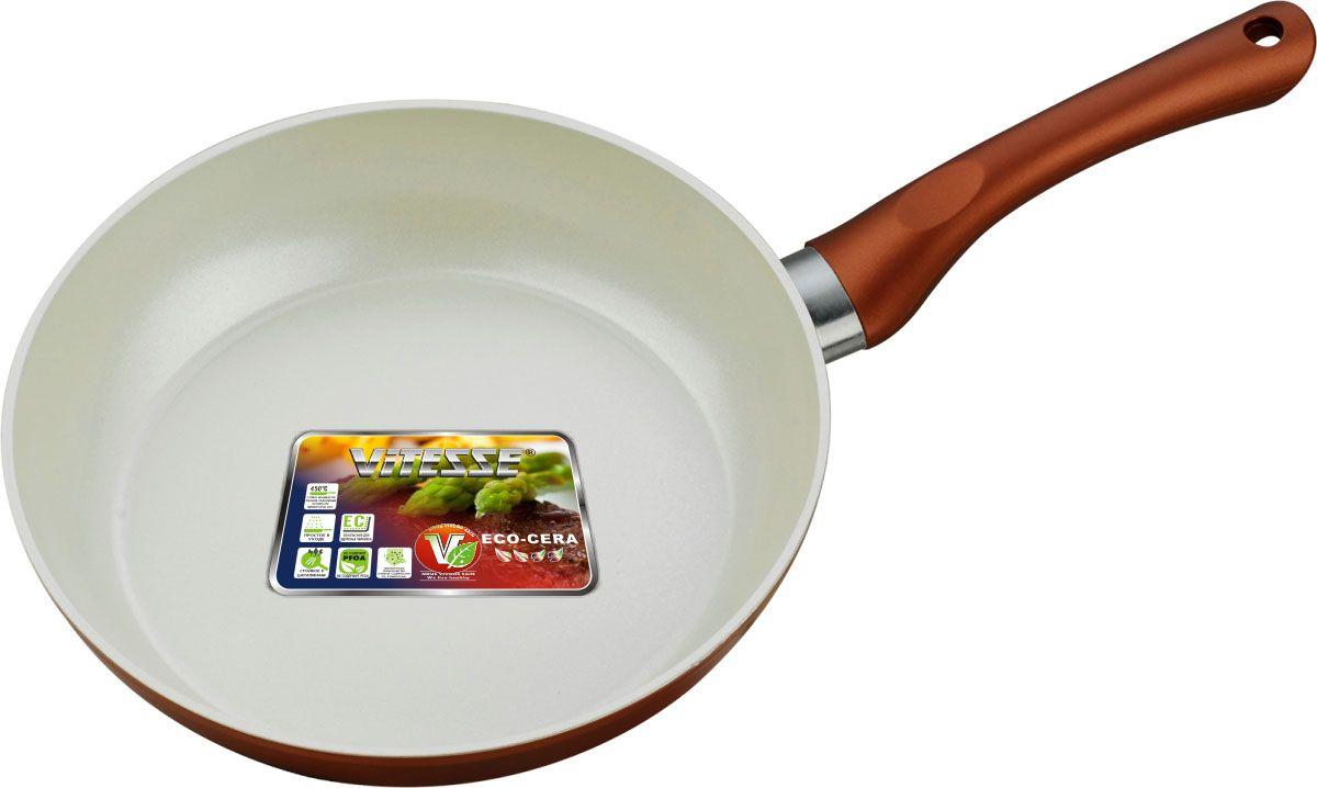 """Сковорода """"Vitesse"""" изготовлена из высококачественного алюминия с   внутренним керамическим покрытием премиум-класса Eco-Cera. Благодаря керамическому   покрытию пища не пригорает и не прилипает к поверхности сковороды, что позволяет   готовить с минимальным количеством масла. Кроме того, такое покрытие абсолютно   безопасно для здоровья человека, так как не содержит вредной примеси PFOA. Покрытие   стойко к высоким температурам (до 450°С), устойчиво к царапинам. Внешнее цветное термостойкое покрытие охраняет цвет долгое время и обладает   жироотталкивающими свойствами.  Дно сковороды снабжено антидеформационным   индукционным диском. Сковорода быстро разогревается, распределяя тепло по всей   поверхности, что позволяет готовить в энергосберегающем режиме, значительно   сокращая время, проведенное у плиты. Сковорода оснащена прочной ненагревающейся бакелитовой ручкой с покрытием Soft-Touch.  Сковорода пригодна для использования на всех типах плит, включая индукционные.   Подходит для чистки в посудомоечной машине.    К сковороде прилагается силиконовая форма в виде цветочка. Она   предназначена   для приготовления яичницы, выпекания блинов необычной формы и т.п. Необходимо   просто залить приготавливаемую массу внутрь формочки, расположенной на сковородке,   и подождать, пока блюдо не дойдет до нужной кондиции. Благодаря такой формочке, вы   привнесете немного оригинальности и разнообразия в свой повседневный завтрак.         Характеристики:  Материал: алюминий, бакелит, силикон.   Цвет: медно-коричневый.   Внутренний диаметр сковороды: 24 см.   Высота стенки сковороды: 5,5 см.   Толщина стенки: 3 мм.   Толщина дна: 5 мм.   Длина ручки: 18 см.   Диаметр индукционного диска: 16 см.   Размер формочки для яиц и оладьев: 10 см х 11,5 см х 2 см.    Кухонная посуда марки """"Vitesse"""" из нержавеющей стали 18/10 предоставит вам все   необходимое для получения удовольствия от приготовления пищи и принесет радость от   его результатов. Посуда """"Vitesse"""" обладает выдающимися функц"""
