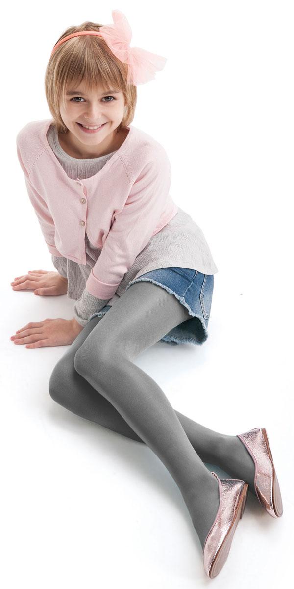 Колготки для девочки Knittex, цвет: серый. Diverse Junior. Размер 116/122Diverse JuniorКолготки для девочки Knittex выполнены из комбинированного материала. Эластичные швы и мягкая резинка на поясе не позволят колготкам сползать и при этом не будут стеснять движений.