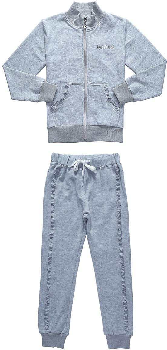 Спортивный костюм для девочки Luminoso, цвет: серый меланж. 728265. Размер 140728265Спортивный костюм для девочки Luminoso состоит из куртки и брюк. Изделия выполнены из эластичного хлопка. Куртка имеет длинные рукава, воротник-стойку и застежку на молнию. Спереди расположены два кармана-кенгуру. Брюки имеют широкую резинку на талии и шнурок для регулировки посадки, а также боковые втачные карманы. Манжеты рукавов, воротник, низ куртки и брючины отделаны эластичной резинкой. Карманы куртки и брюки дополнены рюшами.
