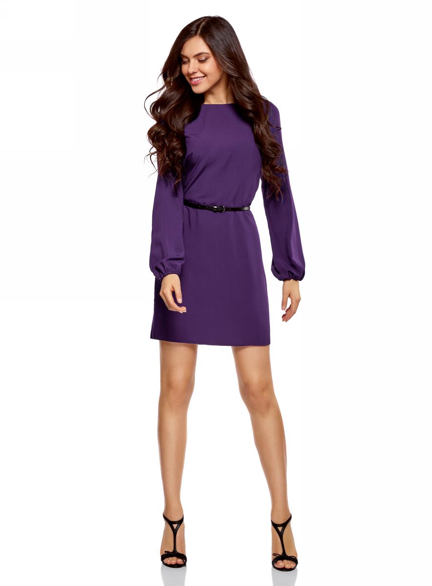 Платье oodji Ultra, цвет: темно-фиолетовый. 11900150-8B/42540/8800N. Размер 38 (44-170)11900150-8B/42540/8800NСтильное короткое платье с длинным рукавом. Модель прямого силуэта с вырезом-лодочкой смотрится сдержанно и элегантно. Длинные прямые рукава собраны снизу на эластичную резинку. Линию талии подчеркивает узкий контрастный ремешок с изящной пряжкой. Легкая и шелковистая ткань из вискозы красиво струится и не стесняет движений. Платье длиной выше колена прекрасно смотрится на самых разных фигурах. Красивое базовое платье - прекрасный выбор для создания деловых и повседневных нарядов. В этом платье днем можно пойти на работу, а вечером отправиться на свидание или встречу с друзьями. Достаточно дополнить его яркими аксессуарами, и у вас получится праздничный наряд! Базовое платье красиво смотрится в сочетании с изящными туфлями на высоком каблуке и элегантным клатчем. А если похолодает, сверху можно накинуть пальто или тренч. В этом платье вы будете чувствовать себя привлекательной в любой ситуации!