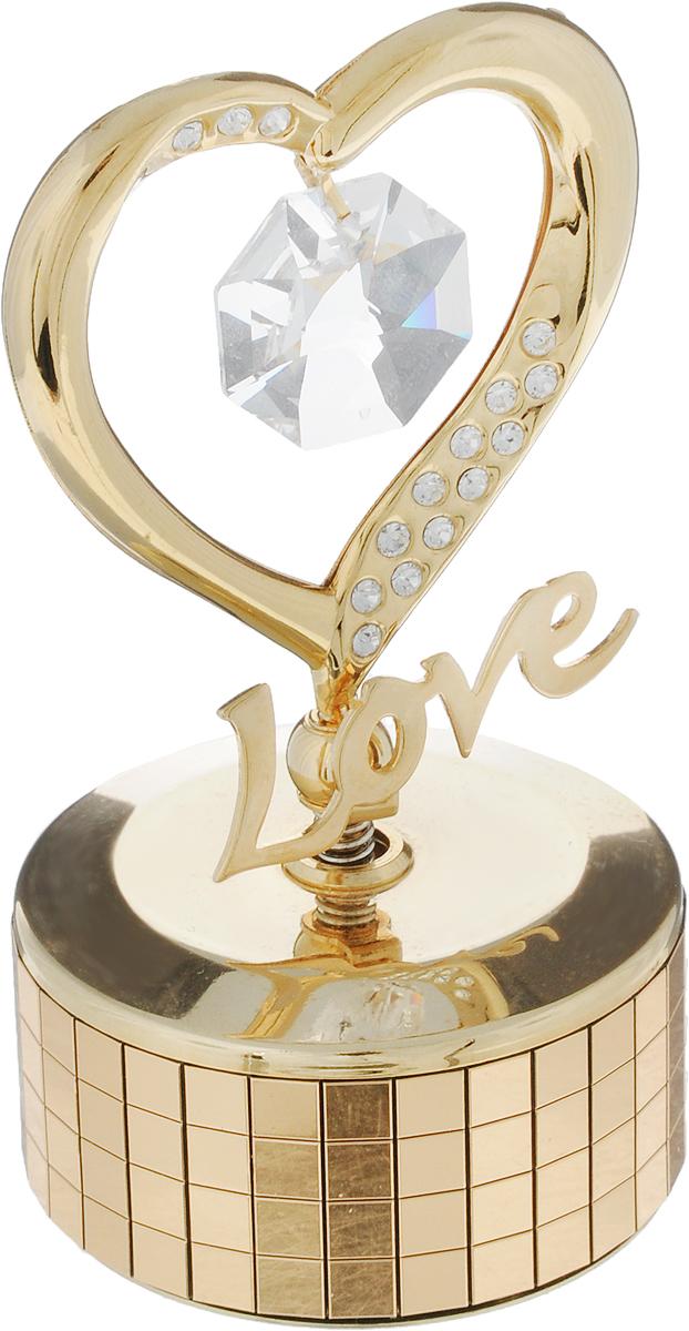 Фигурка декоративная С любовью, цвет: золотистый, на музыкальной подставке67386Декоративная фигурка С любовью, золотистого цвета, станет необычным аксессуаром для вашего интерьера и создаст незабываемую атмосферу. Фигурка выполнена в виде сердца с надписью Love, расположенного на крутящейся подставке с музыкальным механизмом, и инкрустирована цветными кристаллами. Кристаллы, украшающие фигурку, носят громкое имяSwarovski. Ограненные, как бриллианты, кристаллы блистают сотнями тысяч различных оттенков.Эта очаровательная вещь послужит отличным подарком близкому человеку, родственнику или другу, а также подарит приятные мгновения и окунет вас в лучшие воспоминания.Фигурка упакована в подарочную коробку. Характеристики:Материал: металл (углеродистая сталь, покрытие золотом 0,05 микрон), австрийские кристаллы. Размер фигурки: 5 см х 9 см х 5 см. Цвет: золотистый. Размер упаковки: 7,5 см х 10 см х 5 см. Артикул: 67386. Более чем 30 лет назад компанияCrystocraftвыросла из ведущего производителя в перспективную торговую марку, которая задает тенденцию благодаря безупречному чувству красоты и стиля. Компания создает изящные, качественные, яркие сувениры, декорированные кристалламиSwarovskiразличных размеров и оттенков, сочетающие в себе превосходное мастерство обработки металлов и самое высокое качество кристаллов. Каждое изделие оформлено в индивидуальной подарочной упаковке, что придает ему завершенный и презентабельный вид.