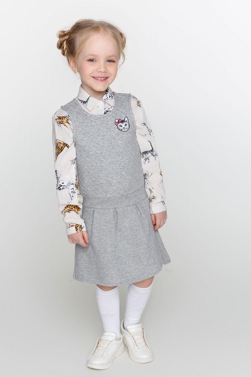 Платье для девочки Acoola Carey, цвет: серый. 20220200183_1900. Размер 11020220200183_1900Уютное платье-сарафан для девочки Acoola Carey, оформленное яркой нашивкой спереди и декоративным запахом на юбке, поможет создать модный повседневный образ и станет отличным дополнением гардероба. Модель, отрезная по линии талии, с круглым вырезом горловины изготовлена из плотного меланжевого трикотажа на основе хлопка с декоративными защипами на юбке. Мягкая ткань приятна на ощупь и комфортна в носке.