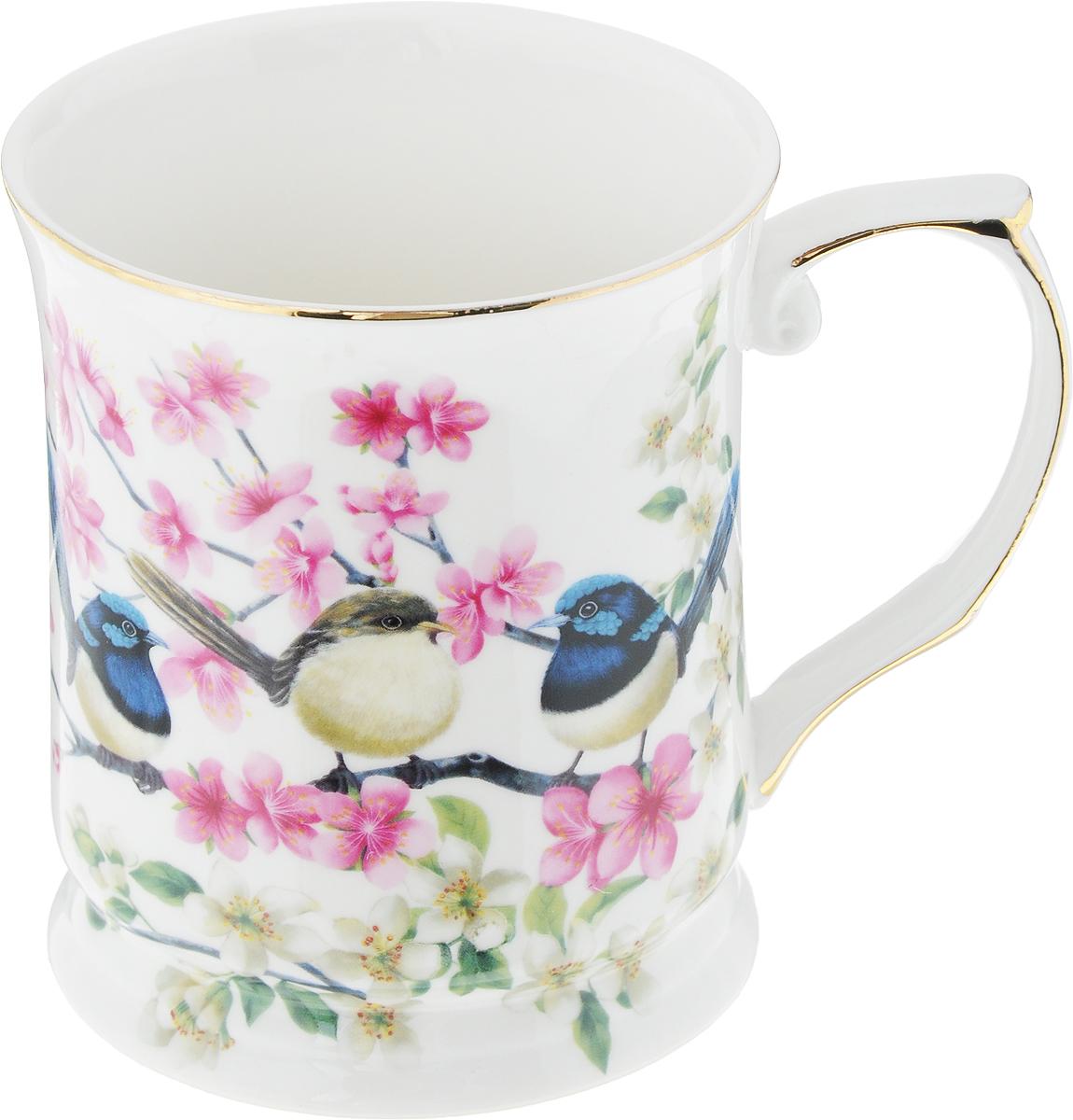 Кружка Elan Gallery Райские птички, 400 мл420036Оригинальная кружка Elan Gallery Райские птички, изготовленная из высококачественной керамики, подойдет для любителей чая, кофе и других напитков. Кружка дополнена удобной ручке и оформлена изображением цветов и птичек. Изделие упаковано в подарочную коробку с ленточкой. Не использовать в микроволновой печи. Объем кружки: 400 мл. Диаметр кружки (по верхнему краю): 9 см. Высота кружки: 10,5 см.