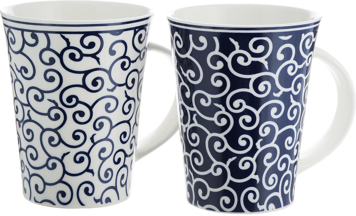 Набор кружек Elan Gallery Арабески, цвет: белый, синий, 320 мл, 2 шт250076Набор Elan Gallery Арабески состоит из двух кружек, выполненных из керамики. Этот необычный набор станет великолепным подарком для каждого и, несомненно, вызовет восхищение.Объем кружек: 320 мл.Диаметр кружек (по верхнему краю): 8,5 см.Высота кружек: 11 см. Не рекомендуется применять абразивные моющие средства. Не использовать в микроволновой печи.