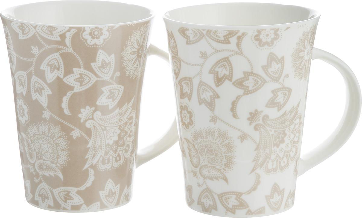Набор кружек Elan Gallery Изящные цветы, цвет: белый, бежевый, 320 мл, 2 шт250083Набор Elan Gallery Изящные цветы состоит из двух кружек, выполненных из керамики. Этот необычный набор станет великолепным подарком для каждого и, несомненно, вызоветвосхищение.Объем кружек: 320 мл.Диаметр кружек (по верхнему краю): 8,5 см.Высота кружек: 11 см. Не рекомендуется применять абразивные моющие средства. Не использовать в микроволновойпечи.